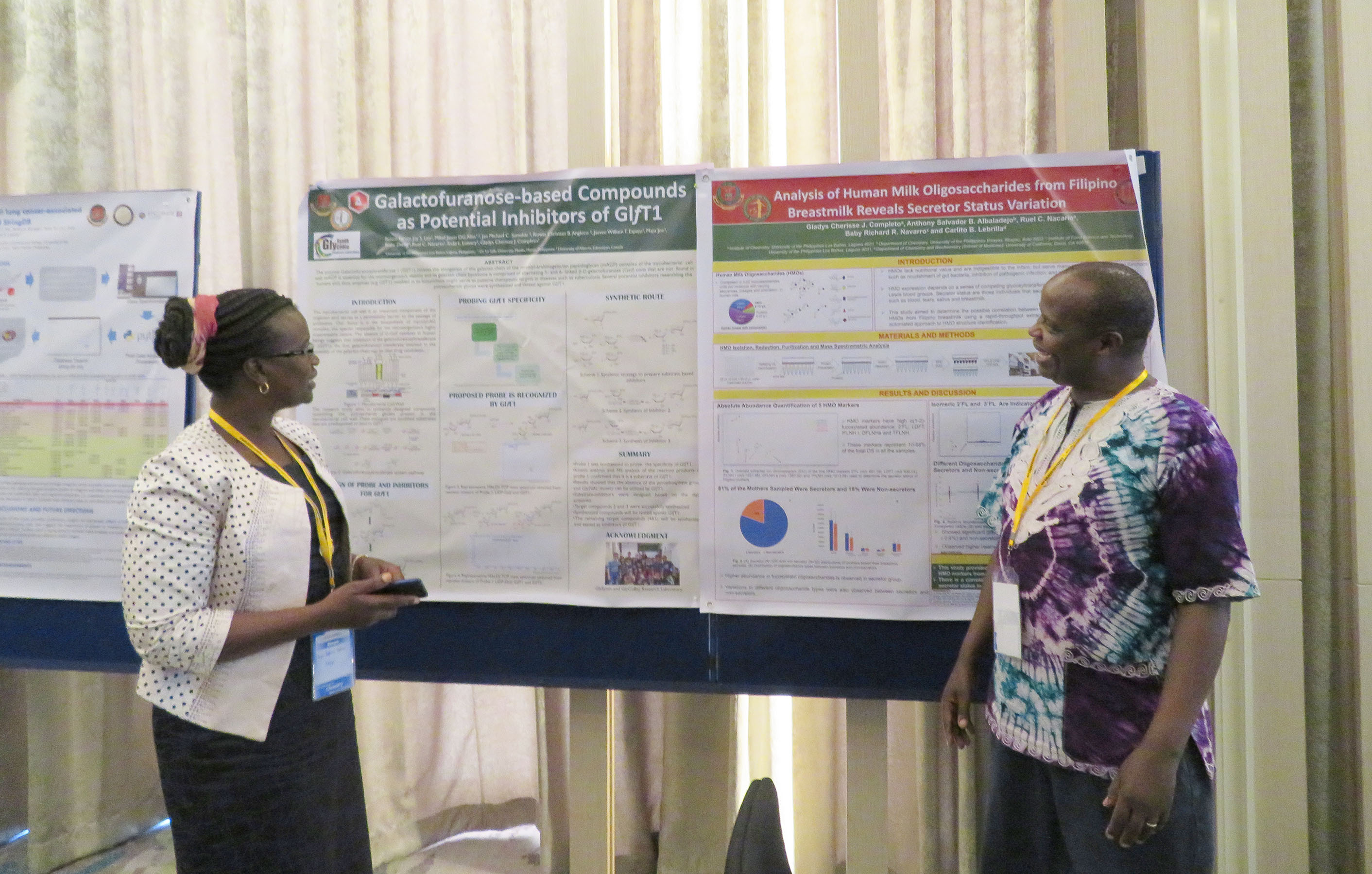 "DR. JOSEPH ""KIP"" RUGUTT, right, associate professor of chemistry at Missouri State University-West Plains, joins Professor Joyce Kiplimo, his colleague from the University of Kabianga in Kenya, in presenting information about the collaborative research project at the Asia International Chemistry Conference in Singapore in September. (Photo provided)"